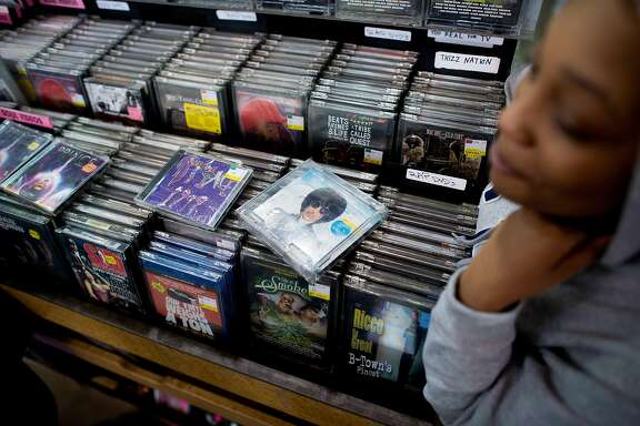Ma'Cherris Johnson-Colbert discusses Prince's music before buying the last of the artist's CDs remaining at Rasputin Music in Berkeley, Calif. on Thursday, April 21, 2016.