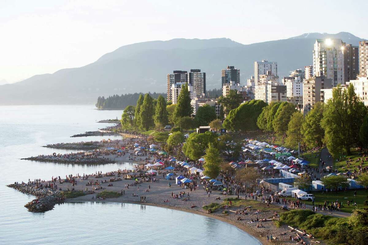 Thousands spread out over Sunset Beach as 420 Vancouver begins to simmer down, in Vancouver, B.C. on Wednesday, April 20, 2016.