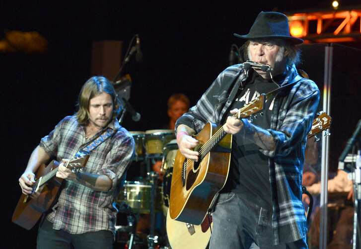 MOUNTAIN VIEW, CA - OCTOBER 25:  Lukas Nelson (L) and Neil Young perform during the 29th Annual Bridge School Benefit at Shoreline Amphitheatre on October 25, 2015 in Mountain View, California.  (Photo by Tim Mosenfelder/Getty Images)