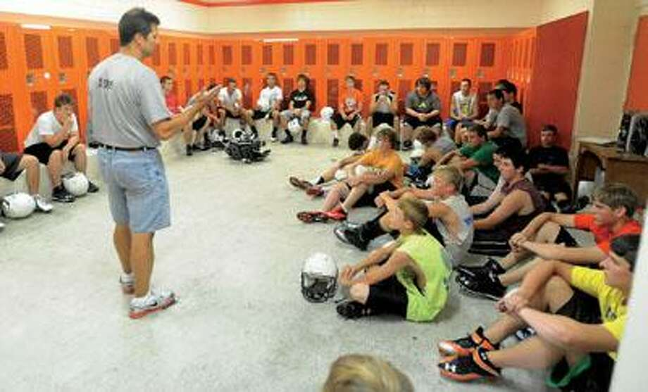 Harbor Beach head football coach Troy Schelke addresses his players prior to their first official practice, Monday.