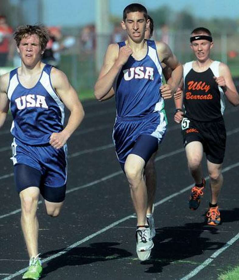 From left, USA teammates Ben Southgate and Nick DeSimpelare lead a pack of runners in the 1,600, including Ubly's Adam Grifka during action on Tuesday at the Laker Rotary Track & Field Invitational.