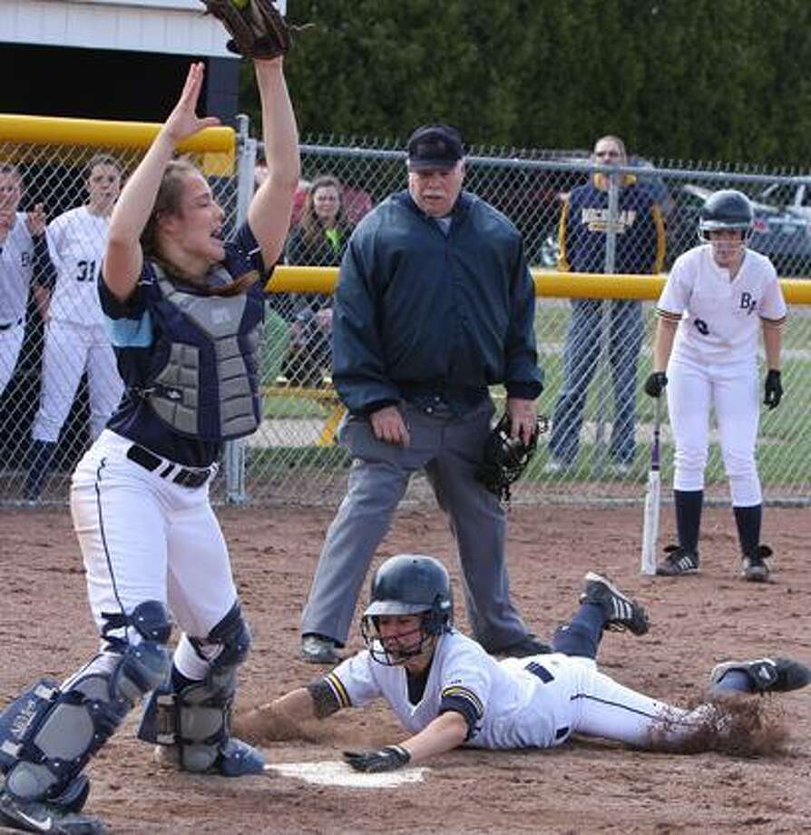 Bad Axe's Taylor Braun is safe at home ahead of the tag from the BCAS catcher in Game 1 on Tuesday.