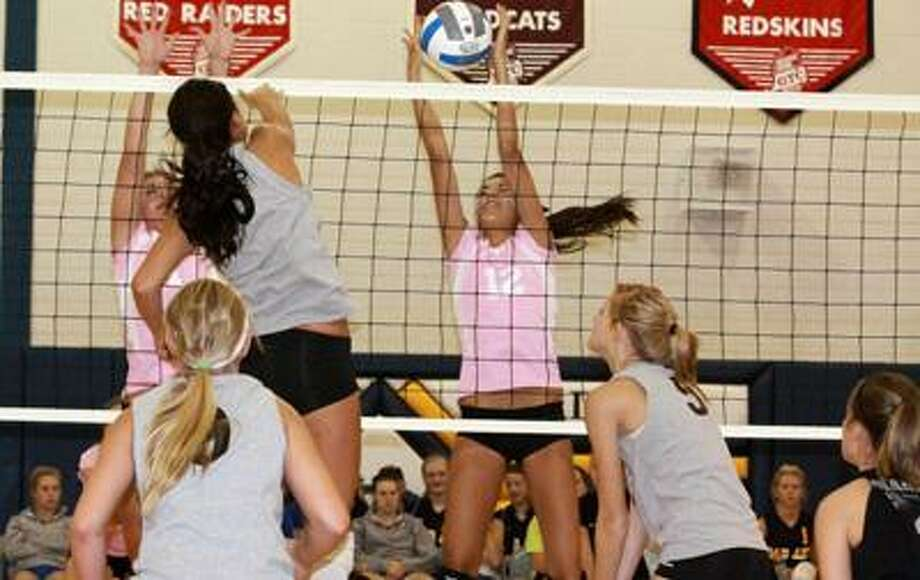 Marlette's Karley Sauder goes up for a successful kill as teammates Marissa Ferguson, Kristen Reinstra and Abby Bowman prepare for the block which never materialized. The Raiders opened the 2011 campaign going 0-3-1 in the Bad Axe Invitational on August 27th.