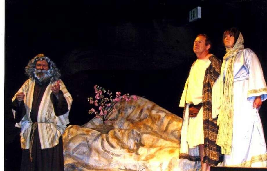 Noah (Gary Sturm) bids farewell to youngest son Japeth (Dan Pratt) and his wife Rachel (Mary Jo Lovejoy).