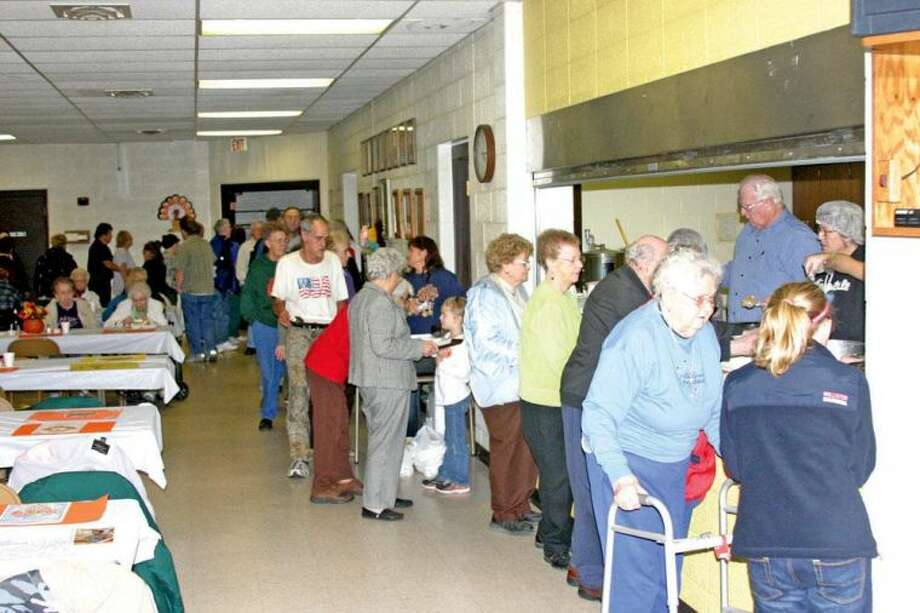People line up for the 24th annual Thanksgiving Blessing Dinner on Thursday at the Sacred Heart parish activity center in Bad Axe.