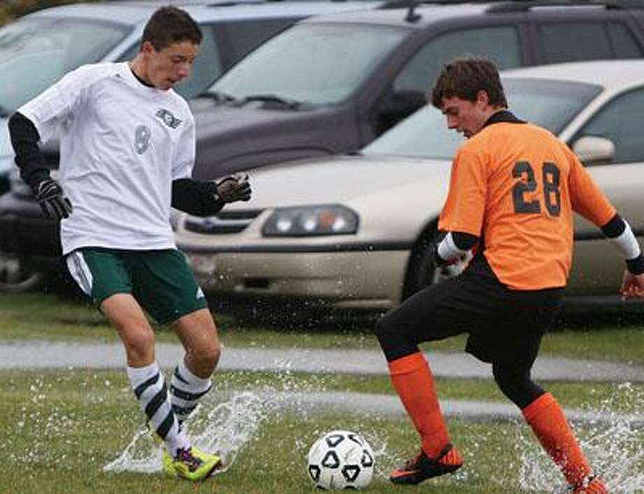 Water sprays as EPBP's Max Lorenz (8) and Harbor Beach's Ashton Roggenbuck go after a ball during the first half of the Lakers' 2-1 overtime victory in the Division 4 district semifinal on Thursday.For more sports photos, go to www.michigansthumb.com and check out the sports gallery.