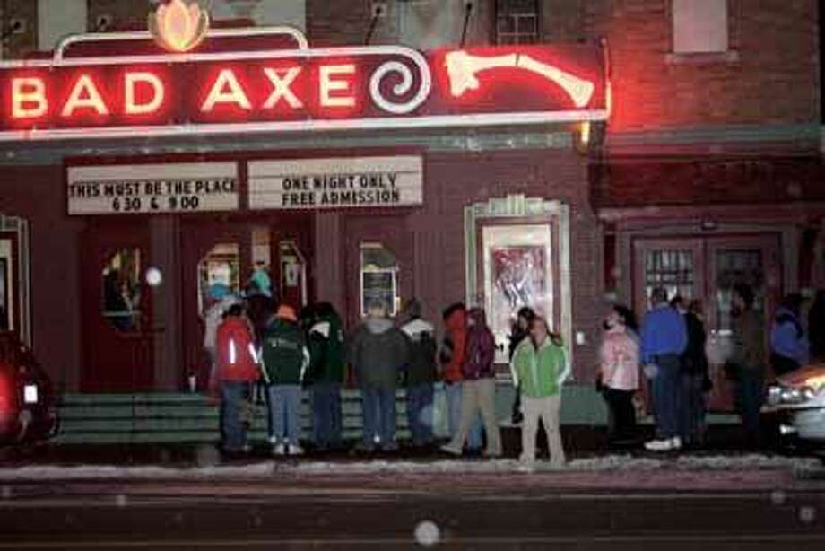 Moviegoers make their way into the Bad Axe Theatre.