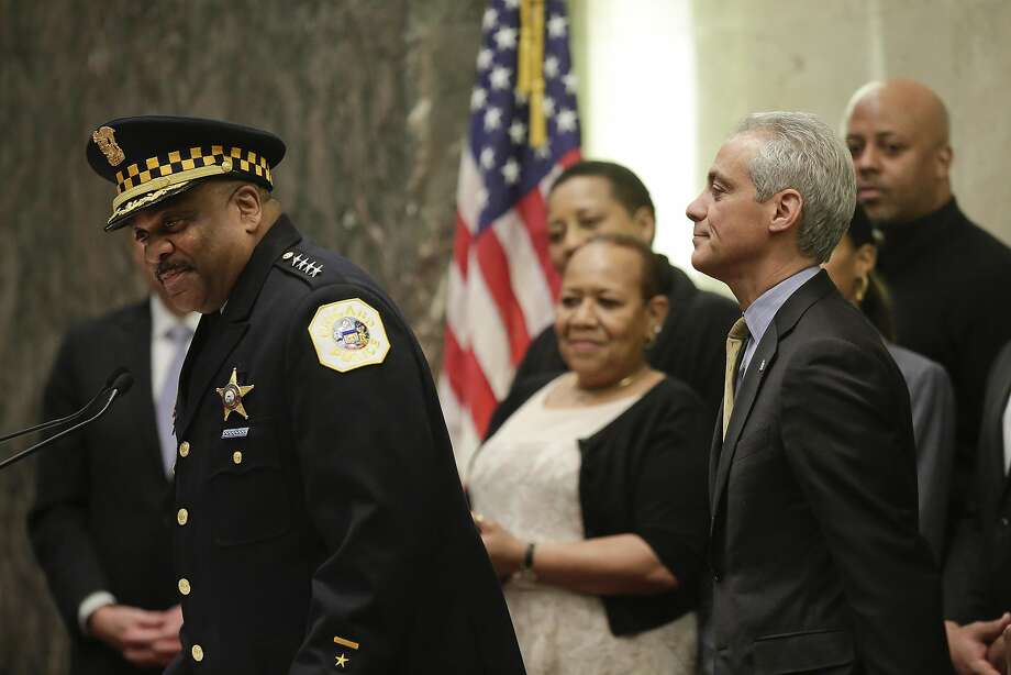 Newly sworn in Chicago Police Superintendent Eddie Johnson speaks to the City Council Chambers, as Mayor Rahm Emanuel looks on, at City Hall in Chicago. Photo: JOSHUA LOTT, NYT