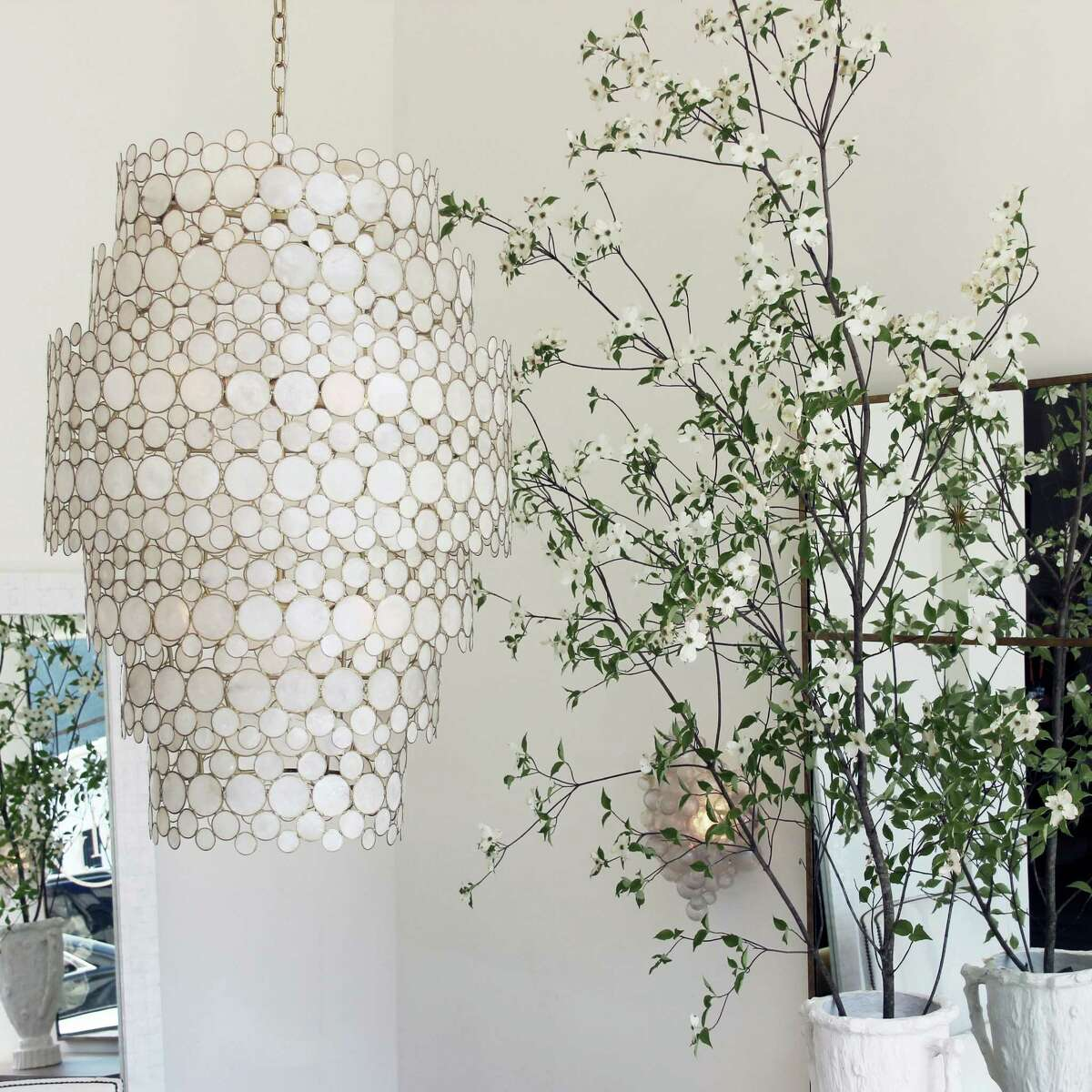 Oly Studio Serena Waterfall Chandelier brings a bit of nature into your home with a brass frame and inlaid Capiz shells.