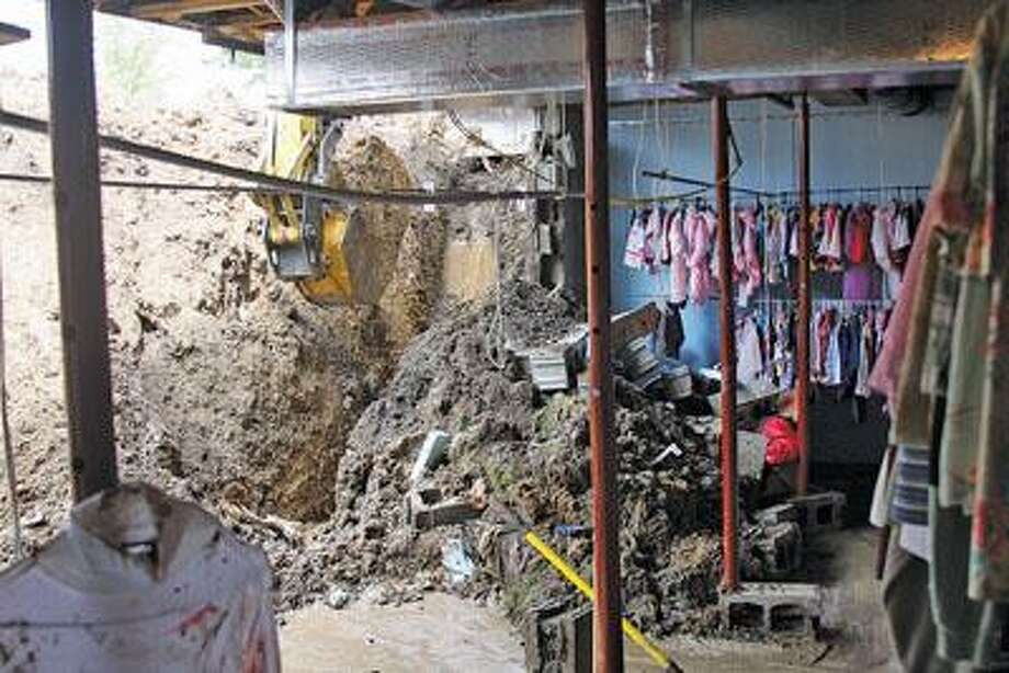A collapsed basement wall at HC's Safeplace.