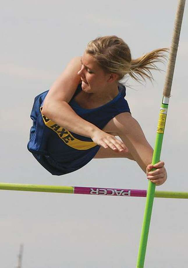 Bad Axe's Lauren Barwig clears the bar in the pole vault on Tuesday.For more sports photos, go to www.michigansthumb.com and click on the sport gallery.