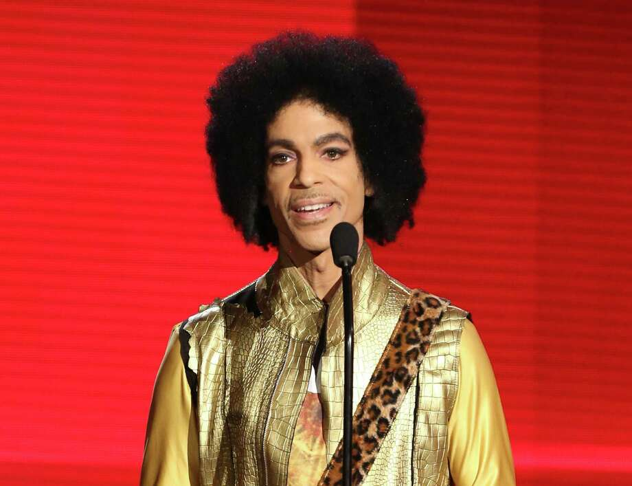 FILE - In this Nov. 22, 2015 file photo, Prince presents the award for favorite album - soul/R&B at the American Music Awards in Los Angeles. Authorities are investigating a death at Paisley Park, where pop superstar Prince has his recording studios. Jason Kamerud, Carver County chief sheriff's deputy, tells the Minneapolis Star Tribune that the investigation began on Thursday morning, April 21, 2016. (Photo by Matt Sayles/Invision/AP, File) Photo: Matt Sayles, INVL / Invision