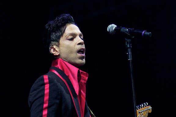 FILE - In this Nov. 14, 2010 file photo, musician Prince performs in Yas Island, on the final night of the F1 motor race meeting in Abu Dhabi, United Arab Emirates. Prince's publicist has confirmed that Prince died at his his home, Thursday, April 21, 2016. He was 57. (AP Photo/Nousha Salimi, File)