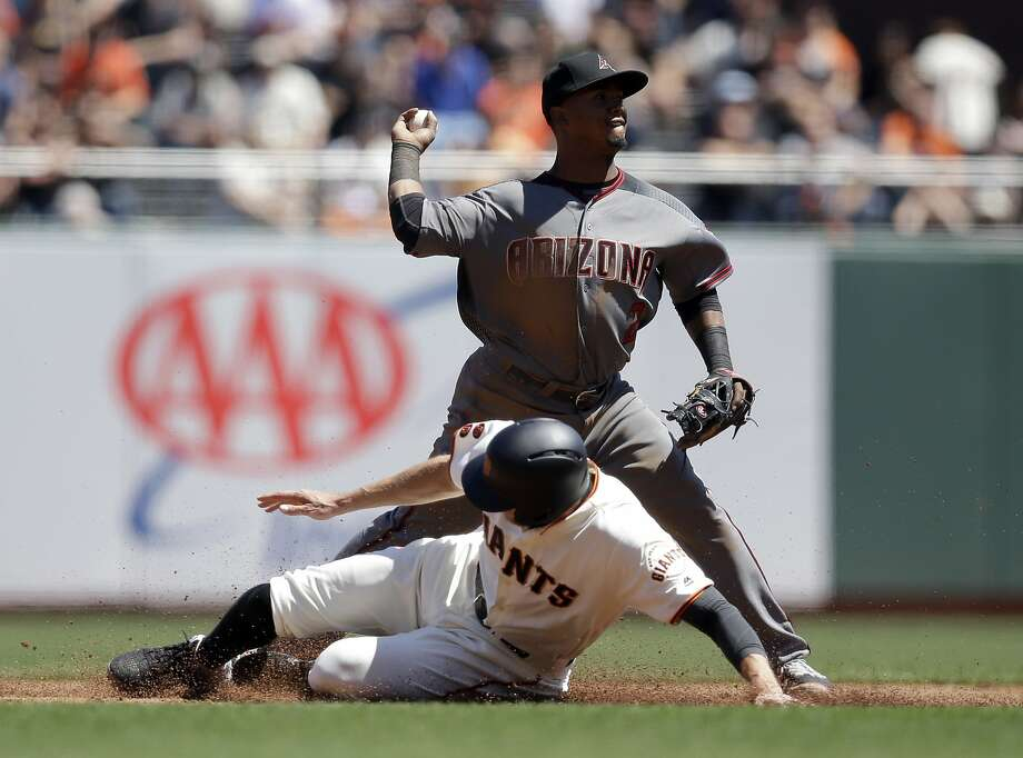 Arizona Diamondbacks second baseman Jean Segura, top, turns a double play over San Francisco Giants' Hunter Pence on a ground ball from Brandon Belt during the third inning of a baseball game, Thursday, April 21, 2016, in San Francisco. Photo: Marcio Jose Sanchez, Associated Press