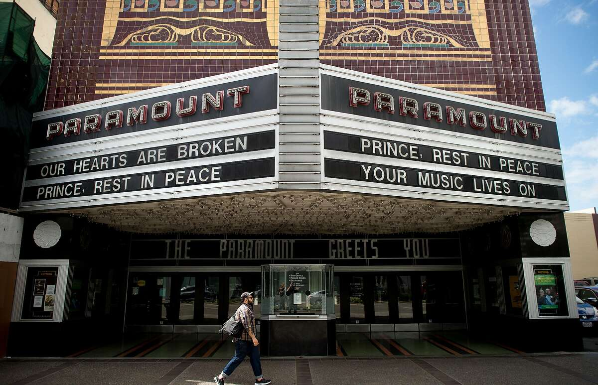 The Paramount Theatre's marquee bears messages marking Prince's death on Thursday, April 21, 2016, in Oakland, Calif. Prince played the venue in February.