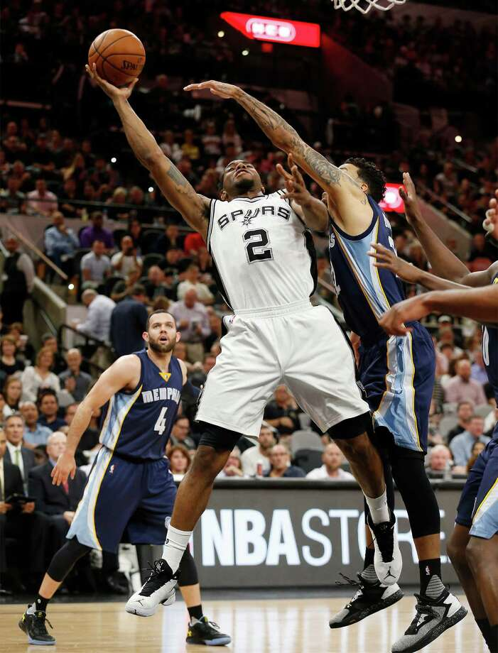 Spurs's Kawhi Leonard (02) goes for a shot against Memphis Grizzlies' Matt Barnes (22) at the AT&T Center in Game 2 of the first round of Western Conference playoffs on Tuesday, Apr. 19, 2016. (Kin Man Hui/San Antonio Express-News) Photo: Kin Man Hui, Staff / San Antonio Express-News / ©2016 San Antonio Express-News