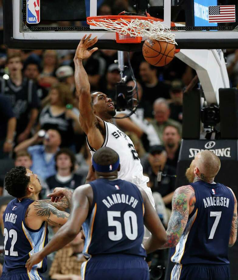 Spurs' Kawhi Leonard (02) dunks against Memphis Grizzlies' Matt Barnes (22), Zach Randolph (50) and Chris Andersen (07) at the AT&T Center in Game 2 of the first round of Western Conference playoffs on Tuesday, Apr. 19, 2016. (Kin Man Hui/San Antonio Express-News) Photo: Kin Man Hui, Staff / San Antonio Express-News / ©2016 San Antonio Express-News