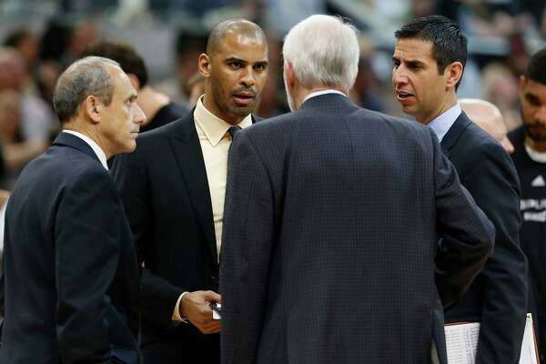 Spurs' coaches Ettore Messina (from left), Ime Udoka and James Borrego gather with head coach Gregg Popovich during a timeout in the game against the Memphis Grizzlies at the AT&T Center in Game 2 of the first round of Western Conference playoffs on Tuesday, Apr. 19, 2016. Spurs defeated the Grizzlies, 94-68. (Kin Man Hui/San Antonio Express-News)