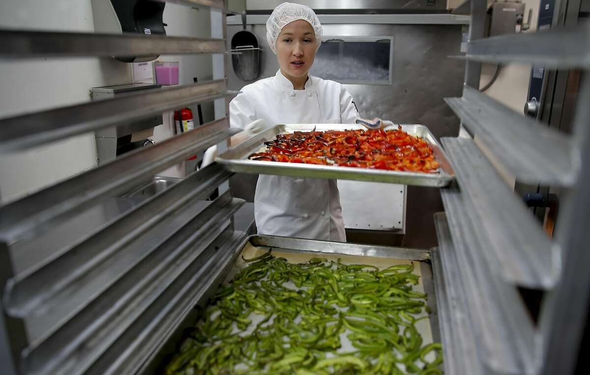 Executive R&D chef Jessica Entzel works the kitchen at Sprig an on-demand food delivery service in San Francisco, California on Thurs. April 21, 2016.