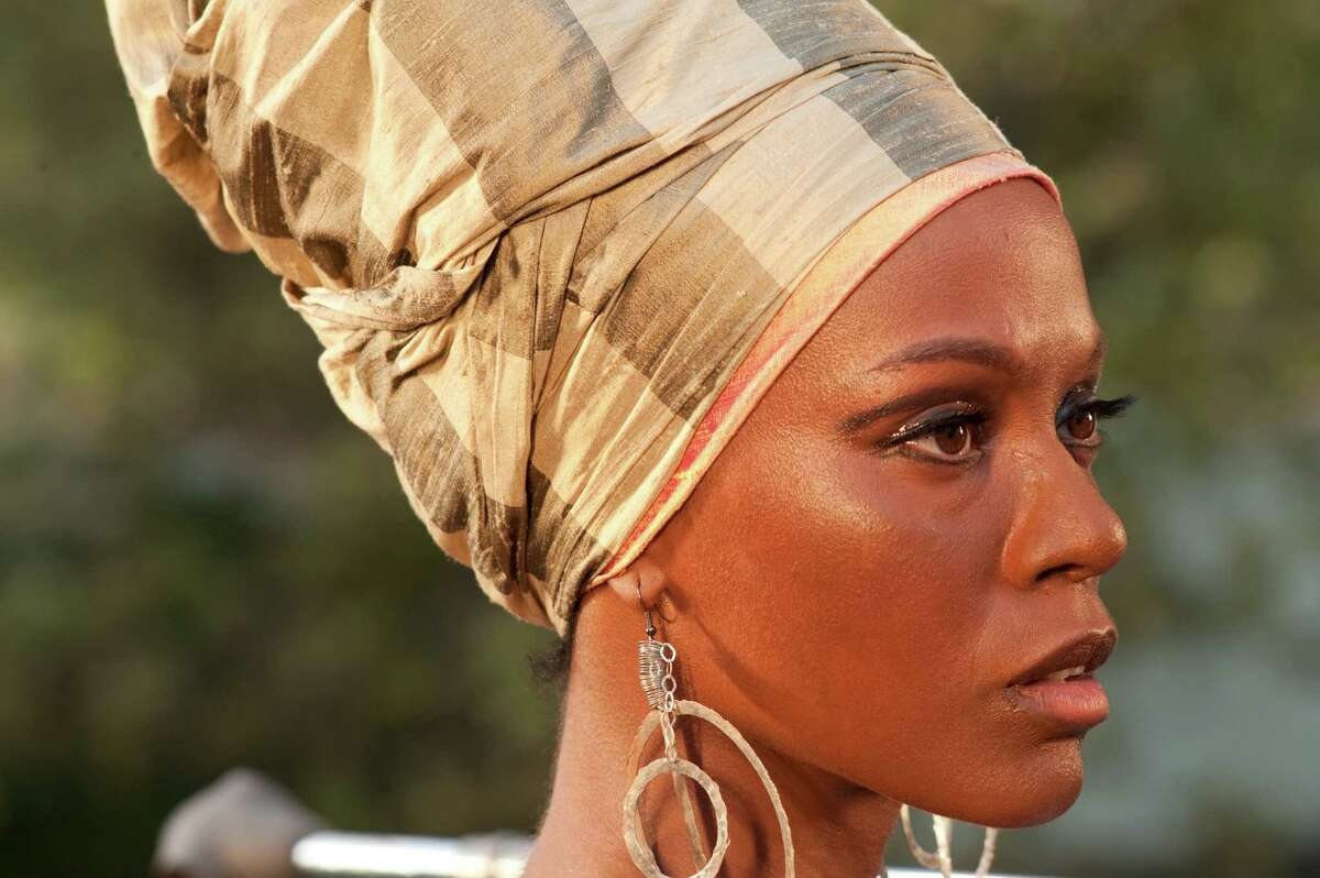 """This image released by RLJ Entertainment shows Zoe Saldana as Nina Simone in a scene from, """"Nina."""" (Suzanne Tenner/RLJ Entertainment via AP)"""