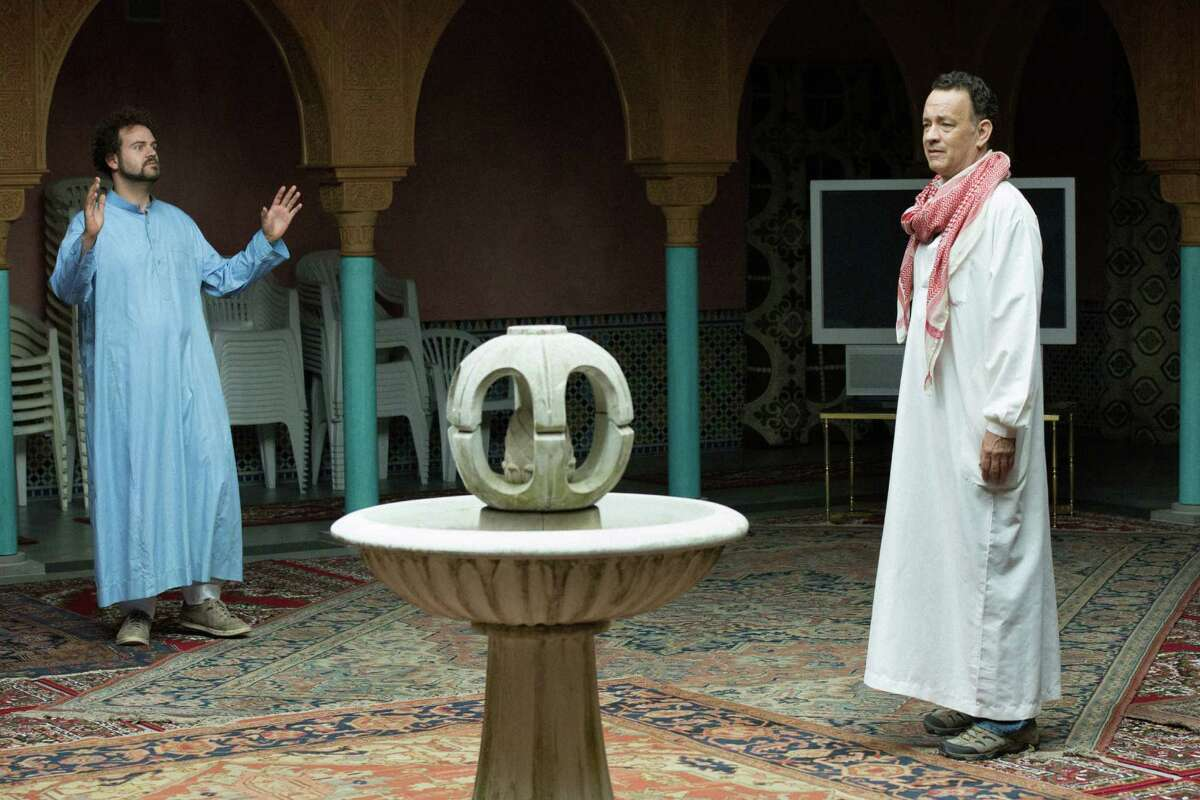 """This image released by the Roadside Attractions shows Alexander Black, left, and Tom Hanks in a scene from """"A Hologram for the King,"""" a film being featured at the Tribeca Film Festival. (Frederic Batier/Roadside Attractions via AP)"""