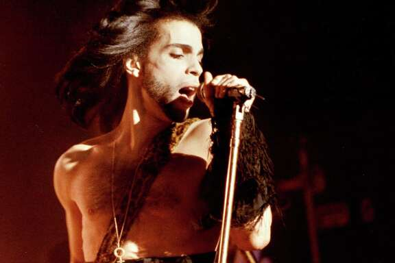 Prince performs at a benefit concert in Minneapolis in May 1990.