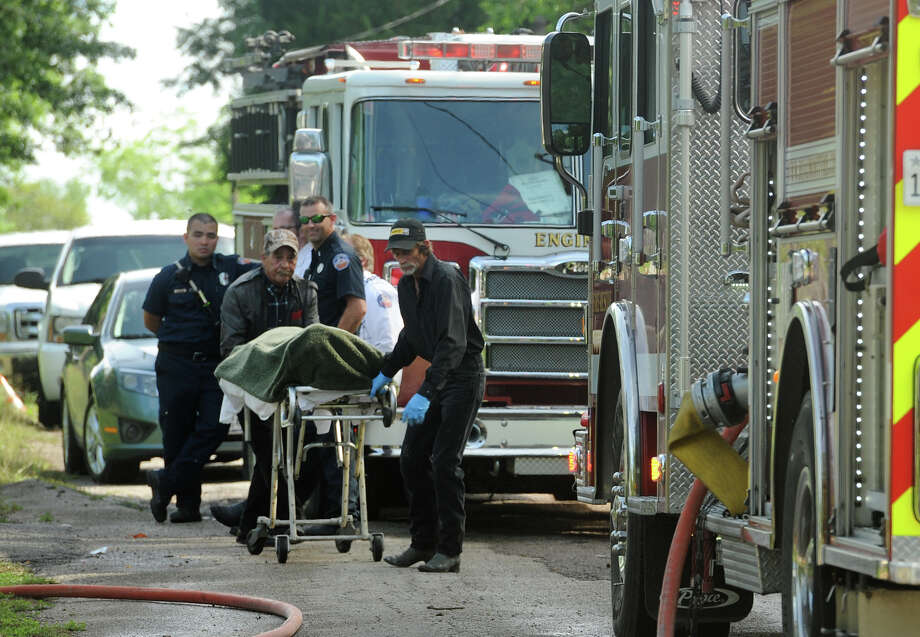 The body of a Beaumont resident is carried from their home after a fire on Taliaferro Street Thursday afternoon.  Photo taken Thursday, April 21, 2016 Guiseppe Barranco/The Enterprise Photo: Guiseppe Barranco, Photo Editor