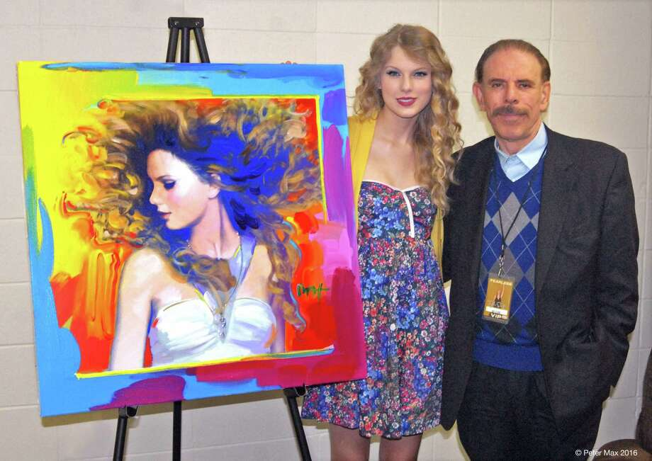 "Peter Max and Taylor Swift on her ""Fearless Tour"" with the portrait he painted of her. They are mutual fans. Photo: © Peter Max 2016. All Photos Courtesy Of The Artist."