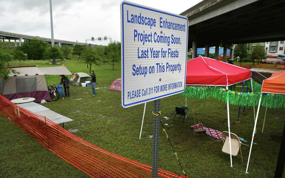A sign in the popular Fiesta parade camping area notifies visitors that the camping tradition — decades long for many families — is coming to an end after 2016. Tuesday, April 25, 2017, mySA.com confirmed with city officials that camping has been reopened in places along Broadway. Photo: Bob Owen / San Antonio Express-News / San Antonio Express-News
