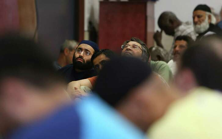 The faithful attend Friday Prayer at the Clear Lake Islamic Center. The mosque's imam is one of 21 people named on a death list published on an Islamic State group website. ( Steve Gonzales  / Houston Chronicle  )
