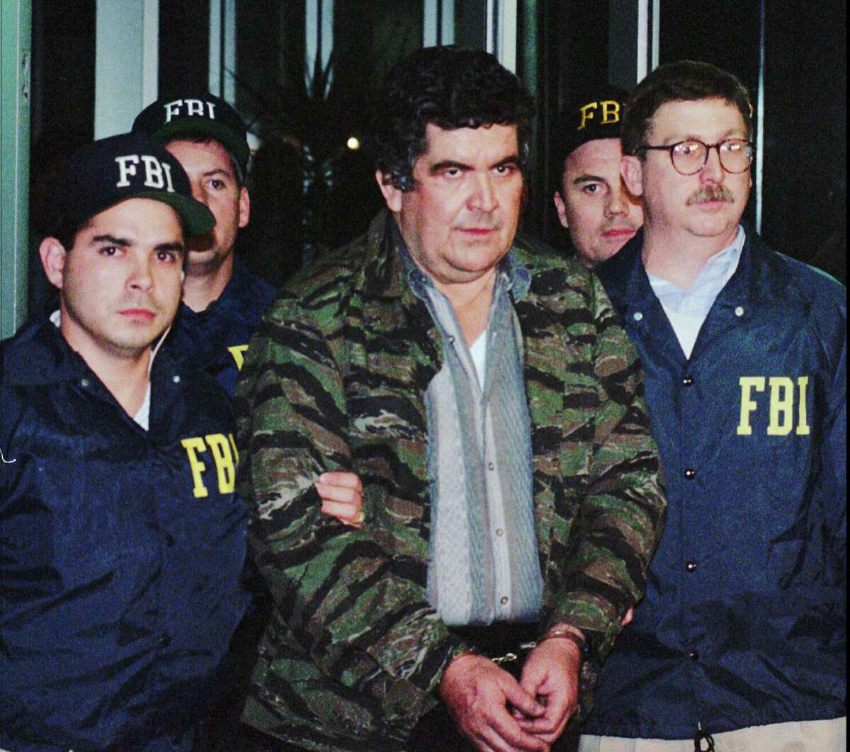 Juan Garcia Abrego is escorted from FBI headquarters in Houston in 1996 after his arrest in Mexico. Garcia Abrego was sentenced to 11 life terms and fined $128 million in 1997.