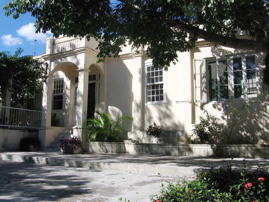 """Ernest Hemingway's stucco Cuban home, Finca Vigia, is where the great writer lived primarily from 1939 to 1960. """"It's nothing grand or spectacular,"""" said UTSA architect William Dupont, who has spent 11 years on its restoration, """"but it's lovely. And very comfortable."""" Photo: Photo Courtesy William Dupont"""