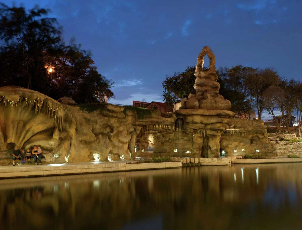 Marvel at Carlos Cortes' grotto, waterfall The concrete artist's work on the Museum Reach creates a glowing, romantic setting.