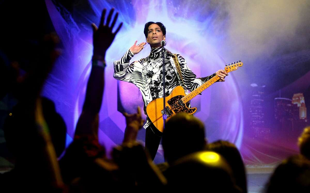 FILE - Musician Prince performs his first of three shows onstage during