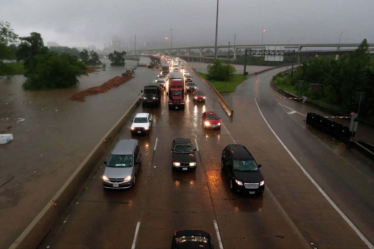 Commuters quickly discovered that roads small and large were covered with water, causing many to close completely throughout the day. Traffic works its way northbound on I-45 North at Quitman as White Oak Bayou comes out of it's banks Monday, April 18, 2016, in Houston.