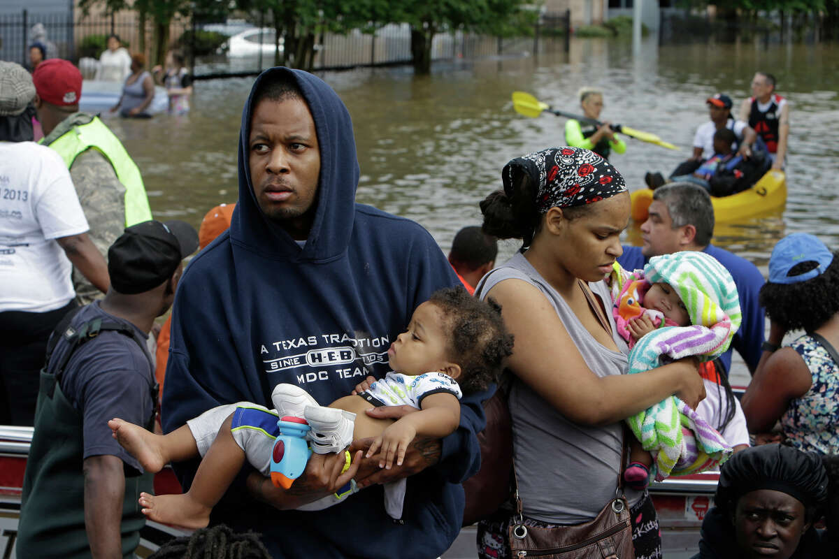 People evacuate from Arbor Court Apartments in Greenspoint on Monday, April 18. (For more photos of Greenspoint flooding, scroll through the gallery.)