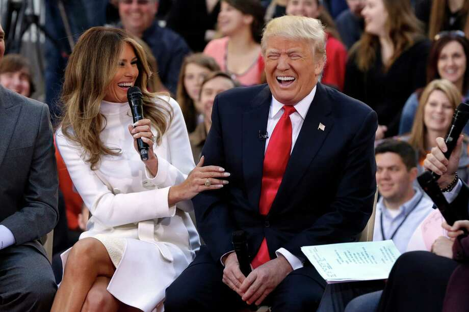 """One of Melania Trump's answers to a question about her husband, Donald, got a big laugh out of him on Thursday during their appearance on NBC's """"Today"""" show in New York. Photo: Richard Drew, STF"""