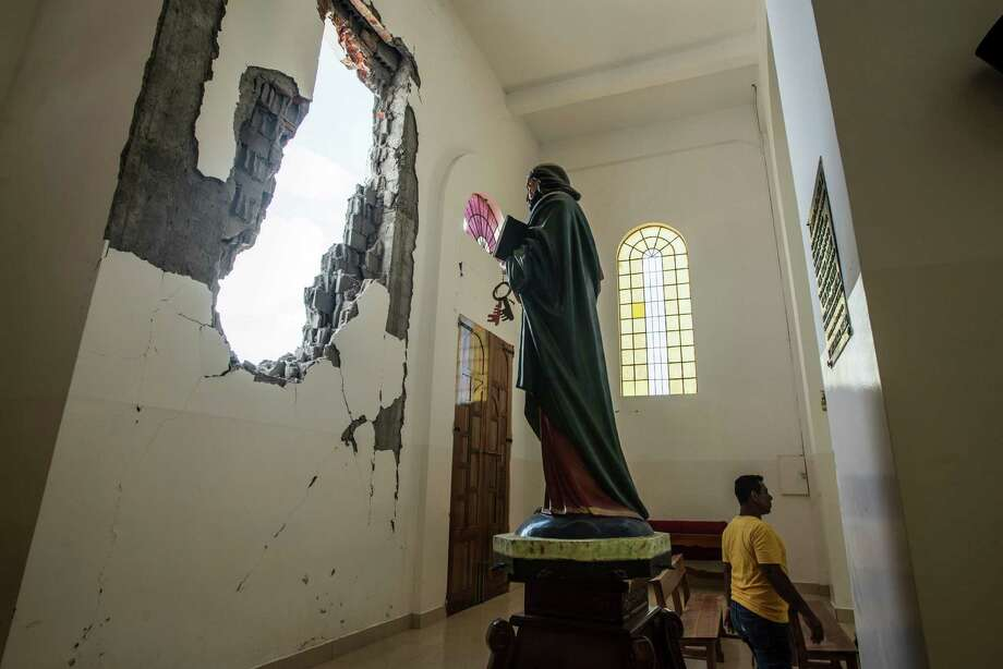 A 7.8-magnitude earthquake upended Montecristi, Ecuador, but the survival of a statue of the Virgin Mary has become a symbol of the persistence. Photo: MERIDITH KOHUT, STR / NYTNS