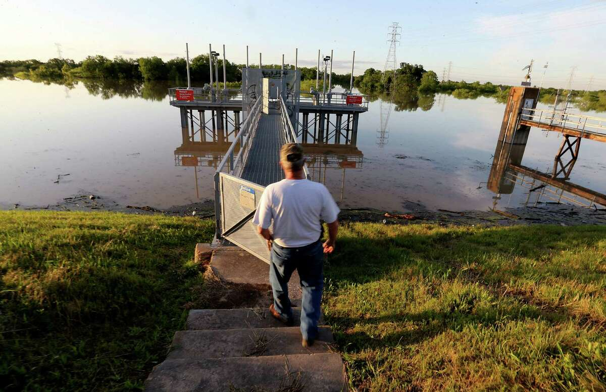 Bill Krampe, engineer for the Army Corps of Engineers, opens one of the levies at the Addicks Reservoir on Thursday in Houston.
