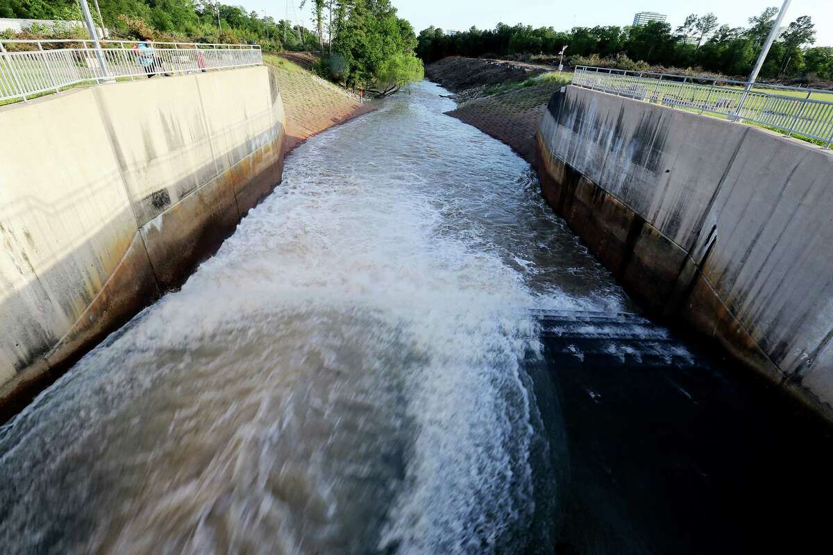 Water is released from the Addicks Reservoir on Thursday in Houston.