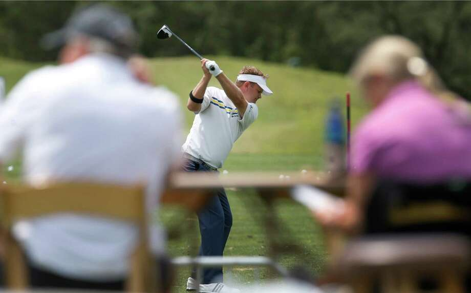 Golfer Billy Hurley, III (center) hits a driver on the practice range before the start of his first-round outing at the 2016 Valero Texas Open at TPC San Antonio on Thursday, Apr. 20, 2016. (Kin Man Hui/San Antonio Express-News) Photo: Kin Man Hui, Staff / San Antonio Express-News / ©2016 San Antonio Express-News