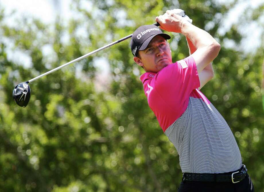 Defending champ Jimmy Walker tracks his tee shot from No. 18 during the first round of the 2016 Valero Texas Open at TPC San Antonio on Thursday, Apr. 21, 2016. (Kin Man Hui/San Antonio Express-News) Photo: Kin Man Hui, Staff / San Antonio Express-News / ©2016 San Antonio Express-News