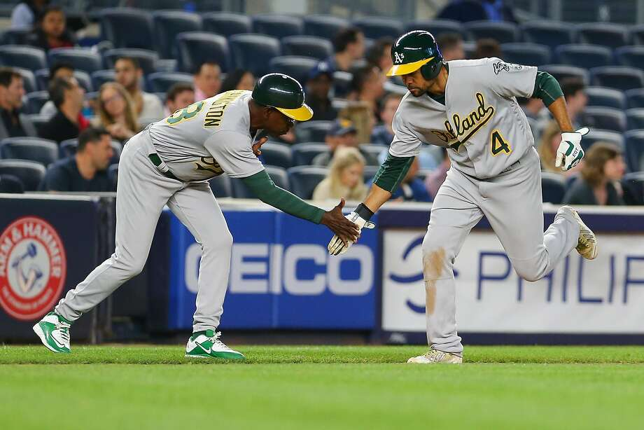 Coco Crisp of the Oakland Athletics celebrates with third base coach Ron Washington #38 after hittinga solo home run in the seventh inning against the New York Yankees at Yankee Stadium on April 21, 2016 in the Bronx borough of New York City.  Photo: Mike Stobe, Getty Images