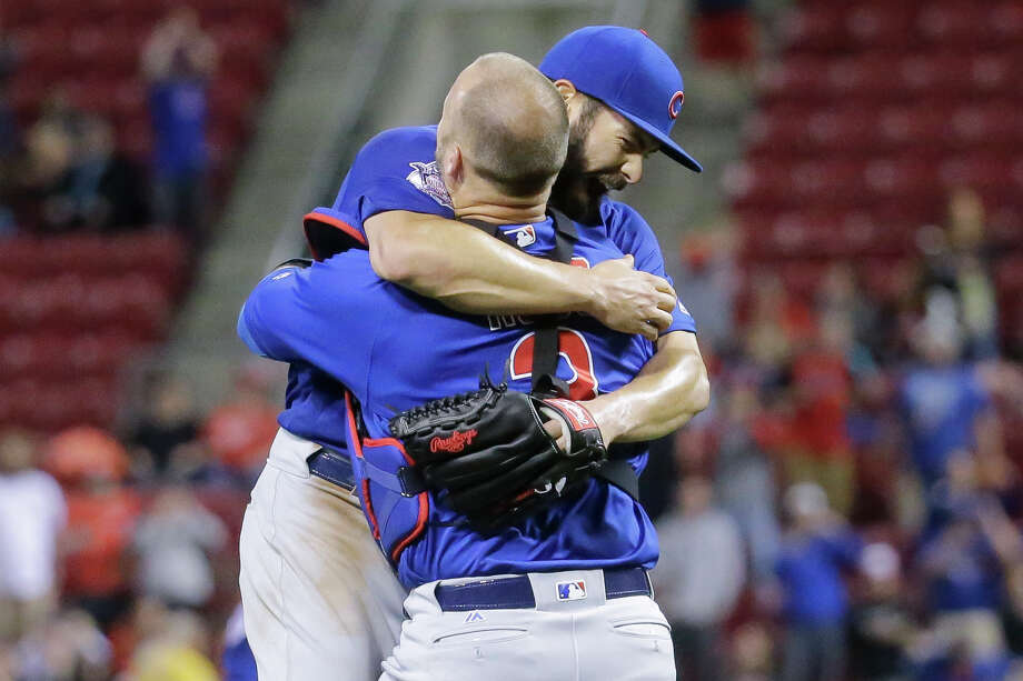 Chicago Cubs starting pitcher Jake Arrieta, left, celebrates with catcher David Ross after the final out of his no-hitter in a baseball game against the Cincinnati Reds, Thursday, April 21, 2016, in Cincinnati. The Cubs won 16-0. (AP Photo/John Minchillo) Photo: John Minchillo, STF / AP