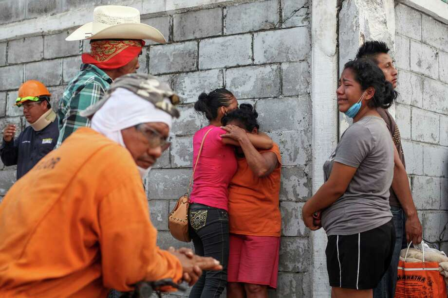 Relatives of missing workers gather Thursday outside a petrochemical complex in Coatzacoalcos, Mexico. At least 13 people are confirmed dead and scores of others were injured in the Wednesday afternoon explosion inside the plant. Officials said 18 workers are missing.  Photo: Felix Marquez, STR / AP