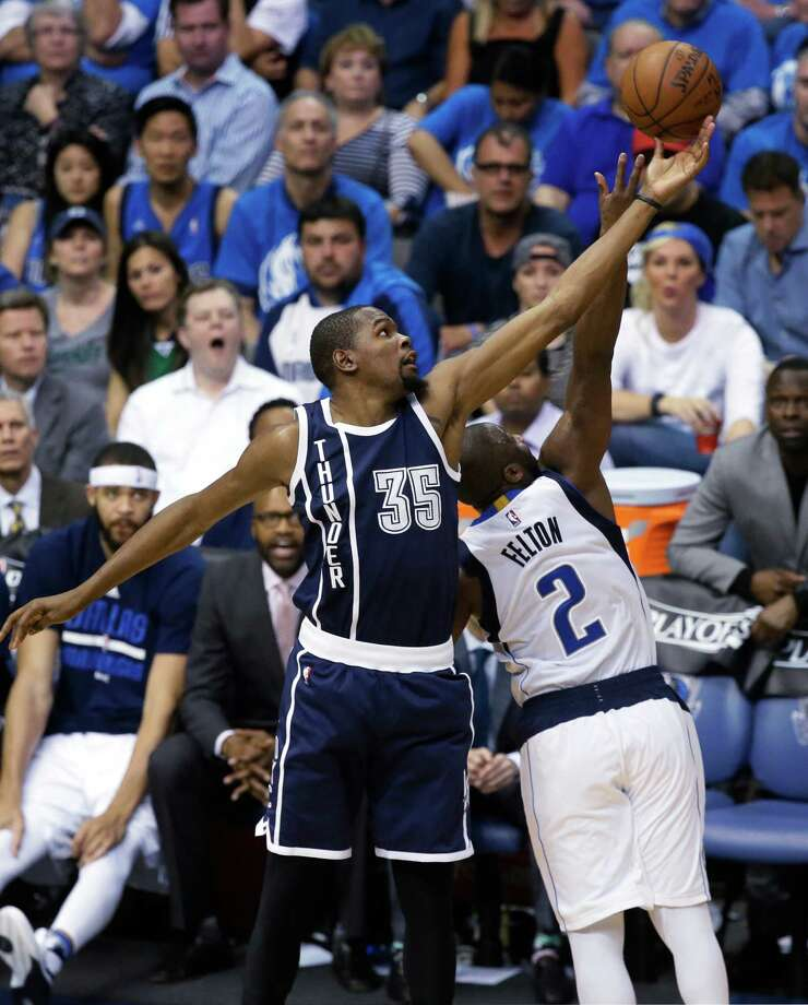 Oklahoma City Thunder forward Kevin Durant (35) reaches for the ball against Dallas Mavericks guard Raymond Felton (2) during the second half in Game 3 of a first-round NBA basketball playoff series Thursday, April 21, 2016, in Dallas. The Thunder won 131-102. (AP Photo/LM Otero) ORG XMIT: DNA118 Photo: LM Otero / Copyright 2016 The Associated Press. All rights reserved. This m