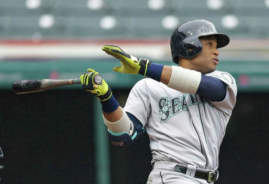 Seattle Mariners' Robinson Cano watches his ball after hitting a three-run home run off Cleveland Indians relief pitcher Cody Allen in the tenth inning of a baseball game, Thursday, April 21, 2016, in Cleveland. Franklin Gutierrez and Luis Sardinas scored on the play. The Mariners won 10-7. (AP Photo/Tony Dejak) ORG XMIT: OHTD109 Photo: Tony Dejak / AP 2016