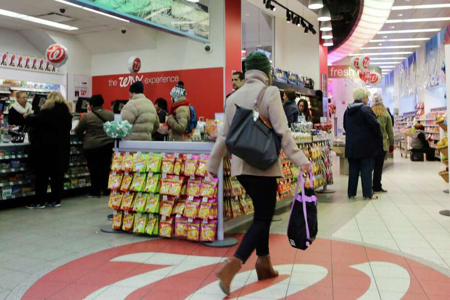 A customer enters a Walgreens in New York. The nation's largest drugstore chain will pay $500,000 to settle charges of duping consumers over prices. Photo: Mark Lennihan, STF