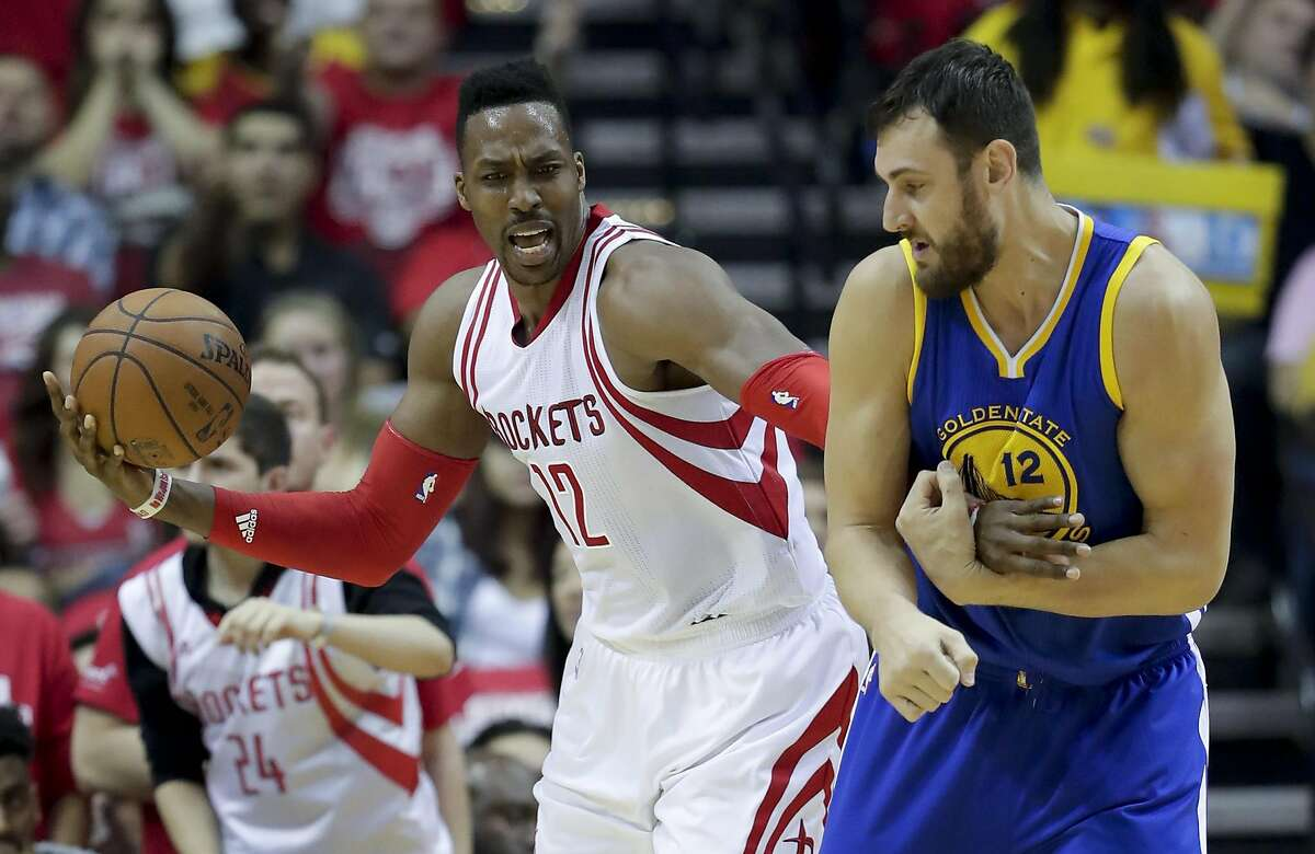 Golden State Warriors center Andrew Bogut, right, fouls Houston Rockets center Dwight Howard during the first half in Game 3 of a first-round NBA basketball playoff series, Thursday, April 21, 2016, in Houston.