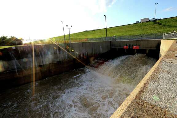 Water is released Thursday afternoon from the Addicks Reservoir, which was at a record depth after this week's rainfall.